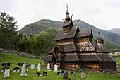 Stave church and graveyard of Borgund, Laerdalsoyri, Laerdal, Norway, Scandinavia, Europe