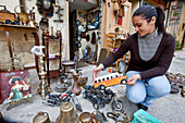 A young woman selling antiques at Victoria, Gozo, Malta, Europe