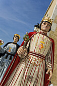 Large figurines at a procession in the city, Festival of Santa Tecla, Sitges, Catalonia, Spain, Europe
