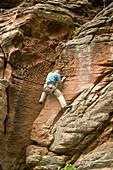 Freeclimber at sandstone rock, Baerenbrunnenhof, Palatine Forest, Rhineland-Palentine, Germany