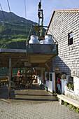 Transporting milk by cable car,  Laufbichl Alpe alpine dairy, Hintersteiner Tal, Bad Hindelang, Allgau, Swabia, Bavaria, Germany