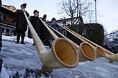 Band of Alpenhorns blowers at the Christmas market in Bad Hindelang, Allgau, Swabia, Bavaria, Germany