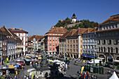 Main square and the remains of the castle on Schlossberg with the clocktower,a Graz landmark, Styria, Austria