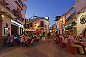 Guests in restaurants in Old Town in the evening, Nerja, Andalusia, Spain