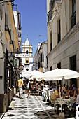 Pavement cafes in a lane, church Iglesia del Socorro in background, Plaza del Socorro, Ronda, Andalusia, Spain