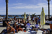 Vacationers in Buddha Beach Club, Puerto Banus, Marbella, Andalusia, Spain