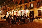 Guests in a pavement cafe at Plaza de la Paja, Madrid, Spain