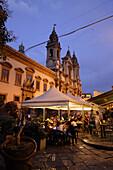Restaurants at Piazza Olivella, Chiesa di Sant'Ignazio all'Olivella in background, Palermo, Sicily, Italy