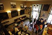 Guests inside the Antica Focacceria San Francesco, Palermo, Sicily, Italy