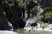 People bathing in Gole della Alcantara, Sicily, Italy