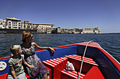 Mother and son having a boat trip, Syracuse, Sicily, Italy