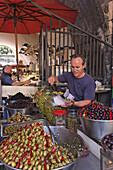 Olives offered on fish market, Catania, Sicily, Italy
