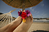 Woman's feet with flowers