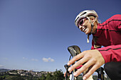 Young woman cycling, Urbino, Marche, Italy