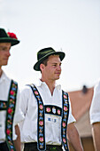 Young men wearing traditional costumes, May Running, Antdorf, Upper Bavaria, Germany