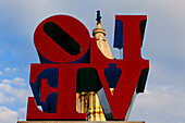 Love sculpture by Robert Indiana in Love Park,with the tower of City Hall in the background, Philadelphia, Pennsylvania, USA