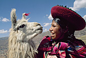 Woman and her llama, Cusco, Peru