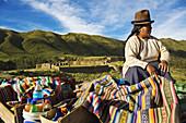 Woman, Pucapucara Incan military complex, Cusco region, Peru