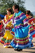 Las Florecitas del Rio Dancers perform at Dia De San Juan Fiesta at the Santa Cruz River Park, Tucson, Arizona, USA