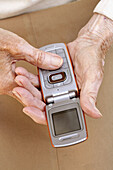 Elderly woman with cellular phone