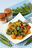 Okra cooked with pumpkin and pepper. Lady fingers. Hibiscus esculentus or Abelmoschus esculentus