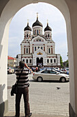 a photographer taking pictures of Alexander Nevski Cathedral Tallinn, Estonia, Baltic States, Northeast Europe.