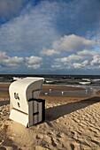 single roofed wicker beach chair at the sandy coast of the isle of Usedom, Western Pomerania, Germany, Europe