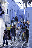 People strolling through the alleys in the evening, Mykonos Town, Greece, Europe