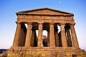 Agrigento, Sicily, Italy  Valley of the Temples Agrakas  Ancient ruins of Greek temple with yellow flowers in foreground  Province of Agrigento