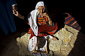 Berber woman weaving in Matmata Berber troglodyte settlement, Tunisia
