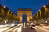 Arc de Triomphe from the Champs Elysees at dusk, motion blur, Paris, France
