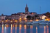 Italy, Sardinia, Western Sardinia, Alghero, city walls from the yacht marina, dawn