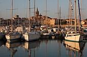 Italy, Sardinia, Western Sardinia, Alghero, city walls from the yacht marina, sunrise