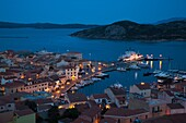 Italy, Sardinia, Northern Sardinia, Isola Maddalena, La Maddalena, aerial port view from the hills, evening