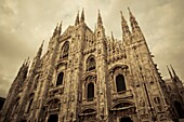 Italy, Lombardy, Milan, Piazza Duomo, Duomo cathedral, defocussed