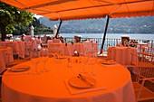 Italy, Lombardy, Lakes Region, Lake Como, Cernobbio, Grand Hotel Villa D´Este, outdoor cafe tables
