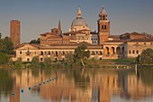 Italy, Lombardy, Mantua, town view and Palazzo Ducale from Lago Inferiore, dawn