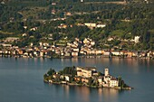 Italy, Piedmont, Lake Orta, Orta San Giulio, high angle view of town and Isola San Giulio from Madonna del Sasso sanctuary