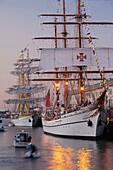 USA,Massachusetts, Boston, Sail Boston Tall Ships Festival, Romanian ship Mircea and Portuguese tall ship Sagres II, dusk