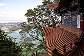 View over temple roof and Dian Lake to Kunming, Hill of the Sleeping Buddha, Taihua Temple, Kunming, Yunnan, People's Republic of China, Asia
