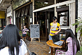 People in front of Vintage Cafe, Kunming, Yunnan, People's Republic of China, Asia