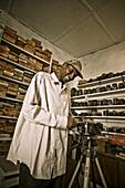 Laughing photgrapher in his studio in Bamako, Mali, Africa