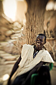 Laughing young man of the Dogon people, Falaise de Bandiagara, Mali, Africa