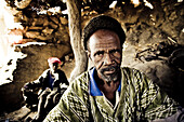 African blacksmith and a helper in a hut, Sangha, La Falaise de Bandiagara, Mali, Africa