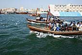 People in boats on Dubai Creek, Dubai, UAE, United Arab Emirates, Middle East, Asia