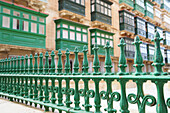 Green railing and houses with oriels, Valletta, Malta, Europe