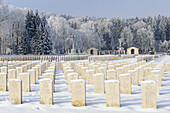 Snow covered graves and cross in Durnbach war cemetery, lake Tegernsee, Duernbach, Upper Bavaria, Bavaria, Germany