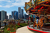 Carousel on Navy Pier and the skyscrapers of downtown Chicago in the background, Illinois, USA