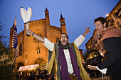 Juggler in front of the cathedral during the festival, Piazza Risorgimento, Palio di Alba, Alba, Piedmont, Italy