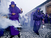 Traditionally dressed men and boys for Easter procession, Antigua, Sacatepequez, Guatemala